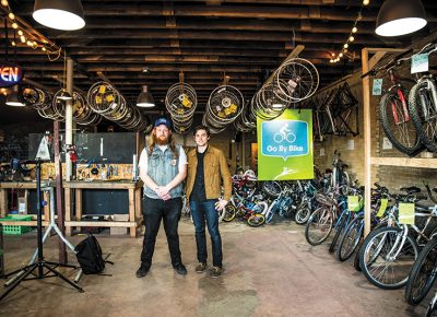 (L–R) Provo Bicycle Collective Assistant Director Kai Cox and Director Austin Taylor have comfortably fit the operation in the Collective's new digs. Photo: Gilbert Cisneros