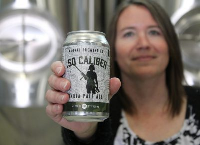 Vernal Brewing Co.'s Owner Ginger Bowden offers a sample of .50 Caliber, their India Pale Ale. Photo by Chris & Sylvia Hollands.