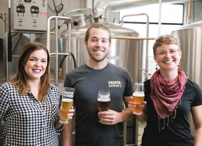 (L–R) Proper Brewing Co. Sales Rep Rebecca Link, Brewer and Head of Packaging Jack Kern and Marketing Coordinator Eleanor Lewis also hold the title of Certified Cicerone, which bespeaks their beer knowledge and expertise. Photo: LmSorenson.net.