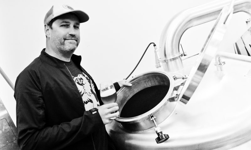 SaltFire Brewing Co. Owner and Founder Ryan Miller cultivated the four-head, manual, counter-pressure bottle-filling machine to start SaltFire in the black. Photo: Andy Fitzgerrell.