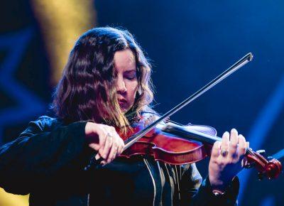 Fiddle player Bridget Regan—an absolute essential piece of the large ensemble that is Flogging Molly. Photo: Lmsorenson.net