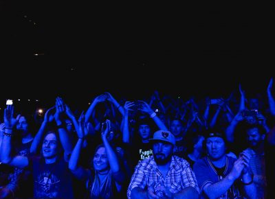 Fans of Flogging Molly being bathed in blue light during the set. Photo: Lmsorenson.net