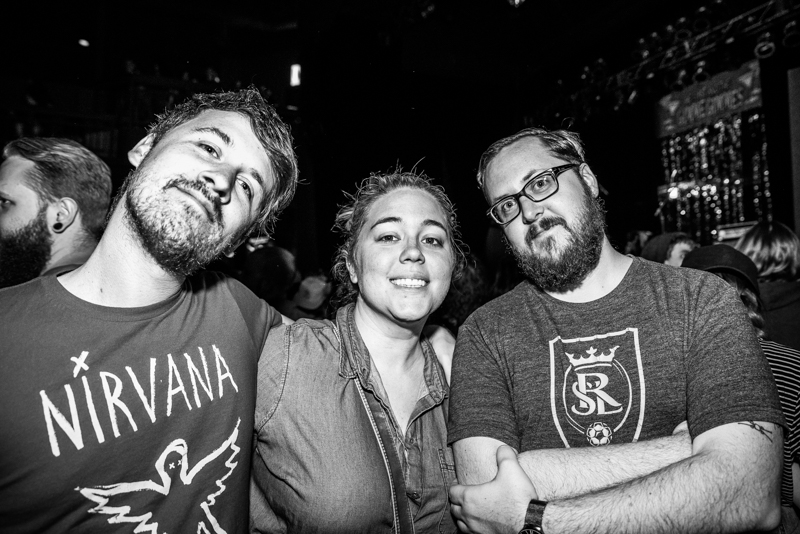 Brad, Jessie and Matt waiting at the front of the stage to see the Gimme Gimmes. Photo: Gilbert Cisneros