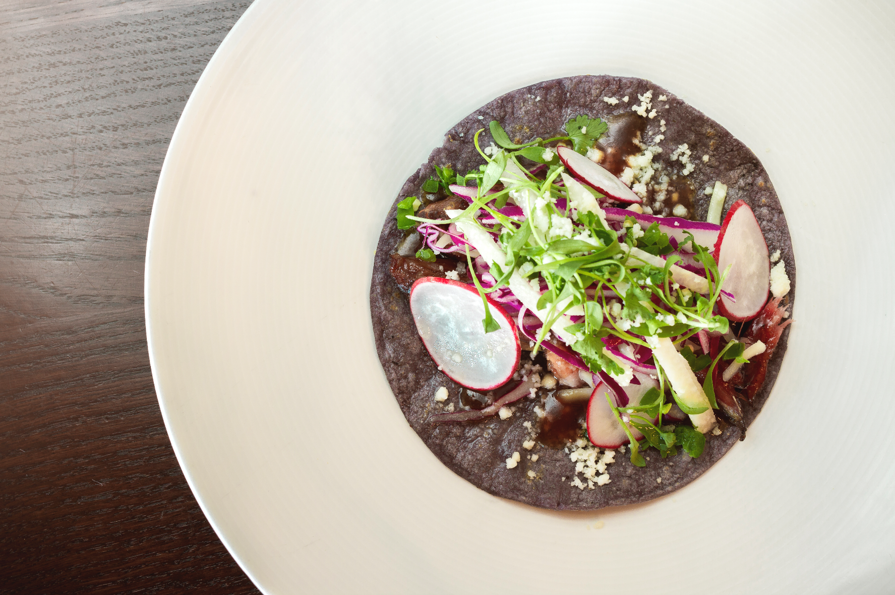 From hog jowl tacos ($18) to bison burgers, Black Sheep at Epic Brewing Sugarhouse has all the contemporary Southwestern and Native American–inspired fixings you'll need to pair with your brews. Photo: Talyn Sherer.
