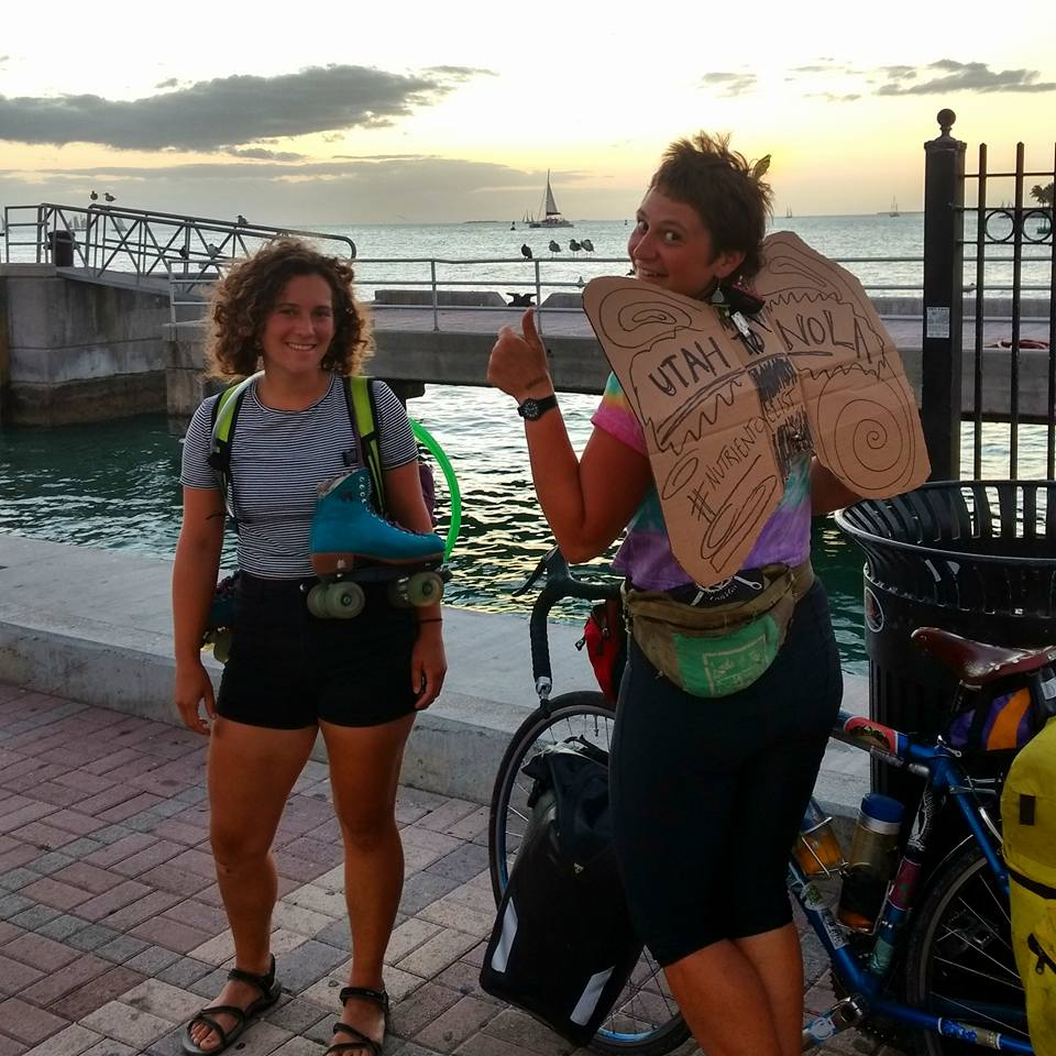 Holly Miller (left), another solo female biker, took a break from bicycling and roller skated the length of the Florida Keys. Arrival at Key West at sunset on the same day. Photo courtesy of Erika Longino.