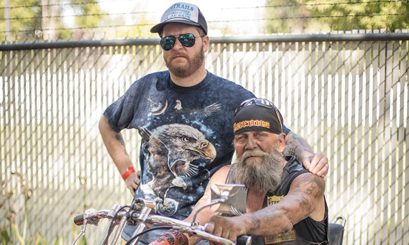 (L–R) Mike Brown poses alongside Baron Motorcycle Club President Dirt Bag, a Baron who's helped keep the spirit of traditional motorcycling culture alive. Photo: John Barkiple