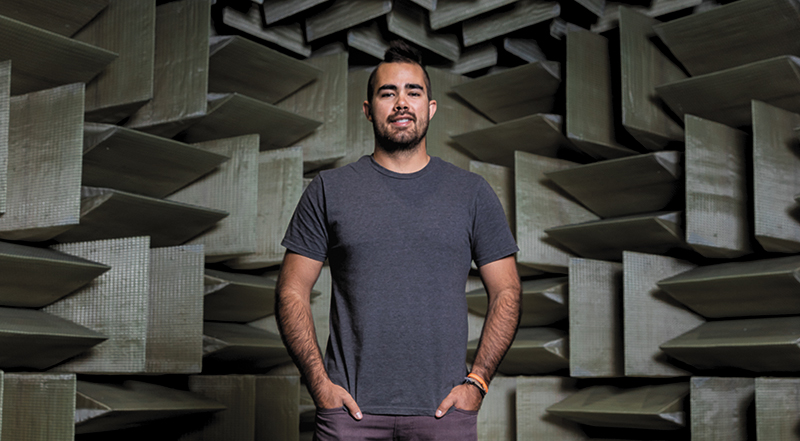 Skullcandy Sr. Manager of Product Experience Sam Noertker stands in the headphone company's anechoic chamber.