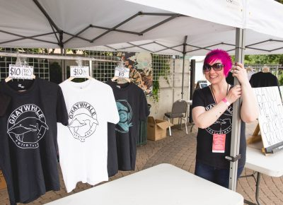 Ruby Barnes from Graywhale Entertainment setting up the merch tent at Ogden Twilight. Photo: Lmsorenson.net