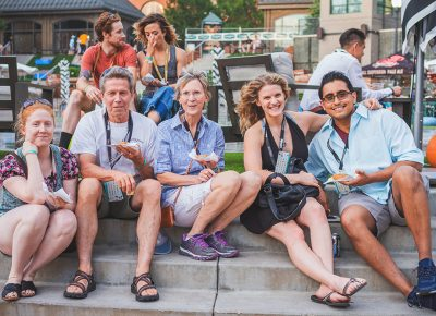 (L–R) Hannah Martineau, Phil, Deborah Byrns, Liz Kiger and Antonio Paramo have to take a seat on the steps of The Gateway's fountain to help the unending supply of food settle. Photo: Talyn Sherer