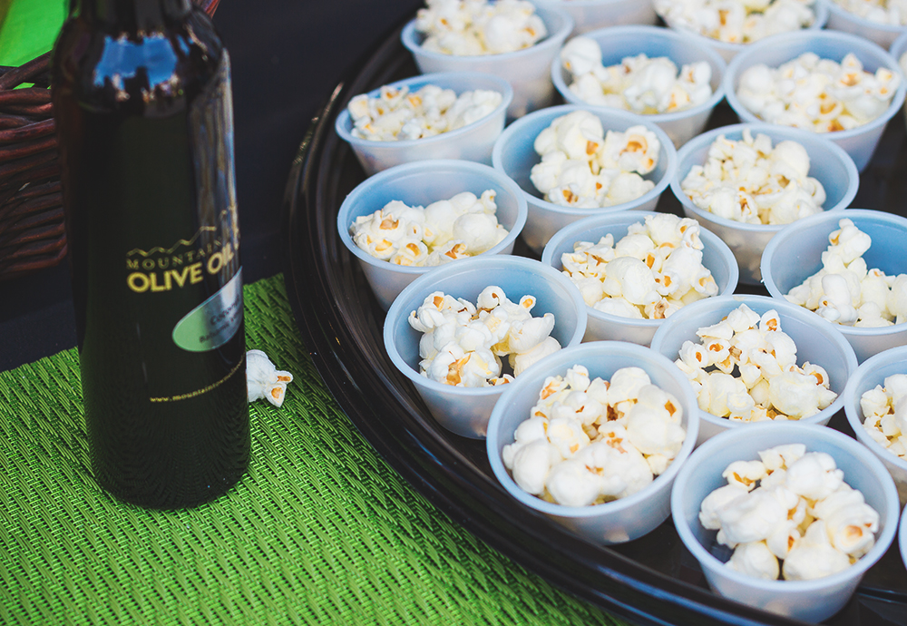 Mountain Town Olive Oil showed us the perfect use of their signature house olive oil, spread over stove-popped popcorn. Photo: Talyn Sherer