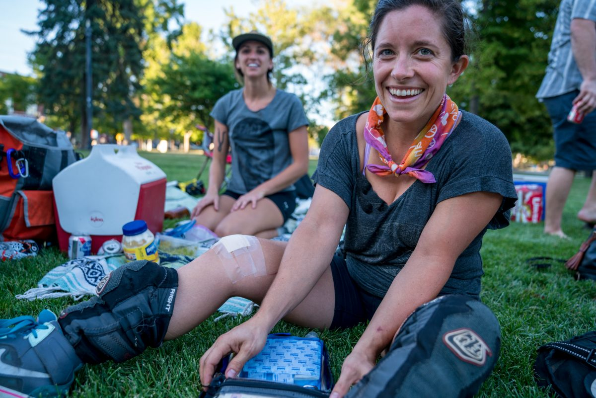 Becky Hedrick uses the first aid kit to cover a battle wound. Photo: Jo Savage // @SavageDangerWolf