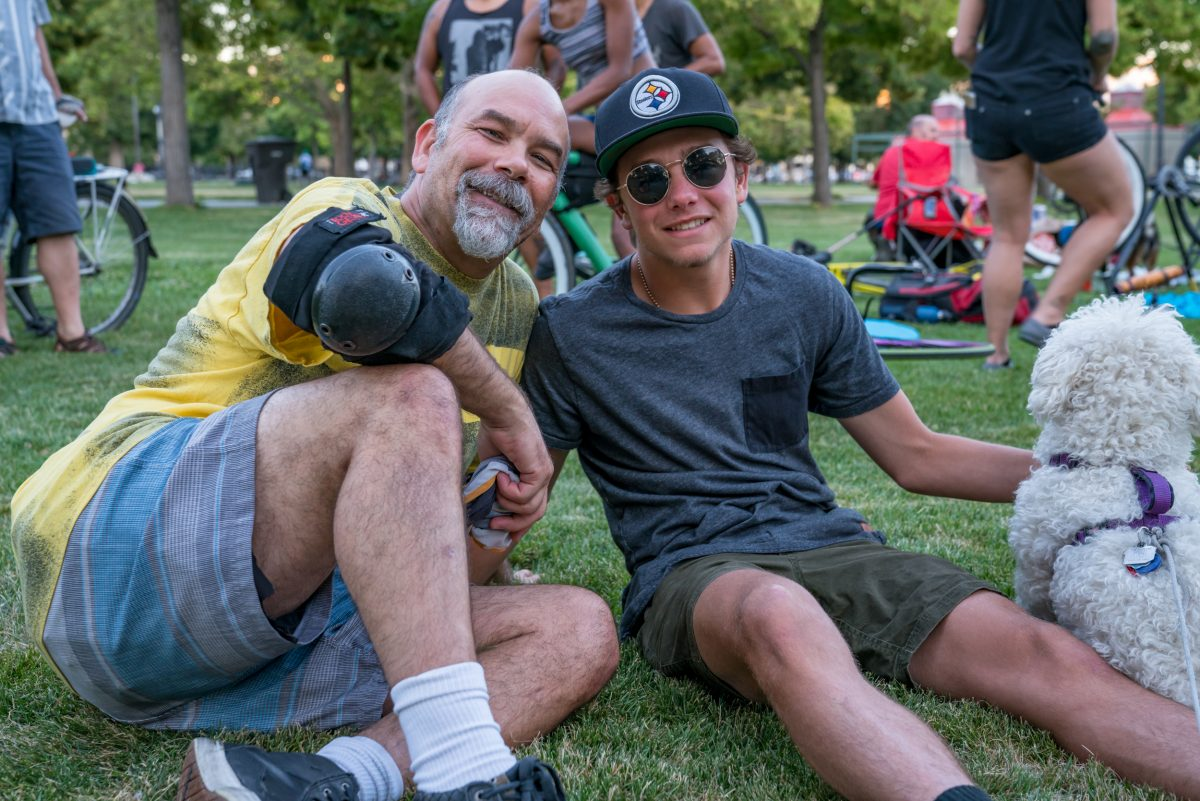 Dan Smith (left) heard about SLC bike polo in 1999 after seeing an ad in City Weekly about polo in Liberty Park. He linked with Chuck Heaton at this point, and the two still play polo together. Now Dan brings his son, Brandis, to the games. Photo: Jo Savage // @SavageDangerWolf