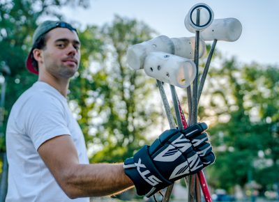 David Barthod holds the mallets. Before each game, the players' mallets are tossed in the air to see who is on what team. Photo: Jo Savage // @SavageDangerWolf