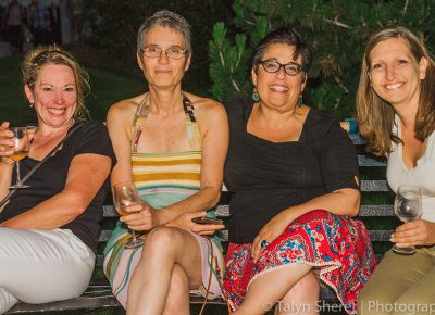 (L–R) Ginger Steensma, Sally Padawer, Amy Martin and Aurelie Ferrut wind down the night with a glass of white wine on a park bench. Photo: Talyn Sherer