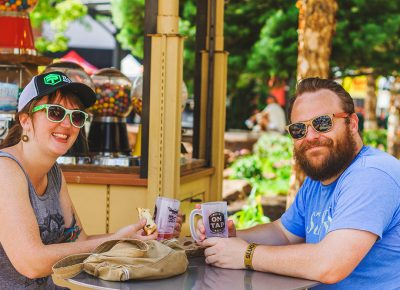 (L–R) Emily Park and Bryant Gordon chill in the shade and converse over their favorite beers. Photo: Talyn Sherer