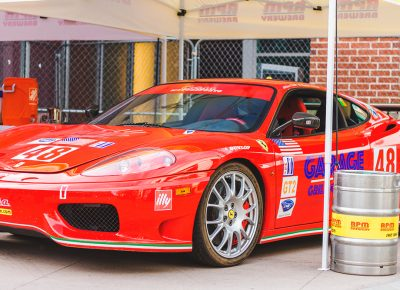 The Garage Grill showcased their badass Ferrari, which rested at the shoulder of the RPM Brewery stand. Photo: Talyn Sherer