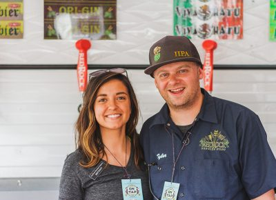 (L–R) Brittany Watts and Tyler Wright repped the Red Rock booth like the true pros that they are. Photo: Talyn Sherer