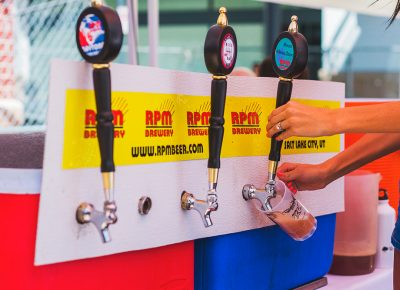 RPM Brewery pours up an frosty glass of beer for their thirsty crowd of diehard fans. Photo: Talyn Sherer