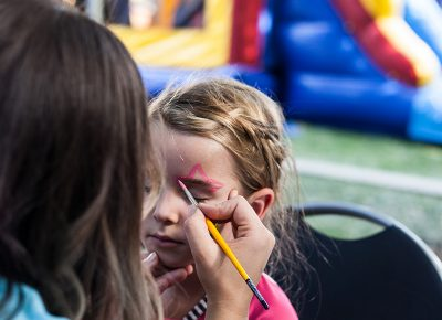 Annie gets an awesome face-painting job in the Kids Area. Photo: Chris Gariety