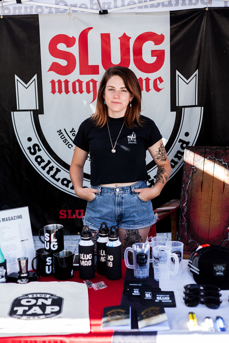 SLUG's own Alex Topolewski makes sure everything's running smoothly at the SLUG Mag booth. Photo: Chris Gariety