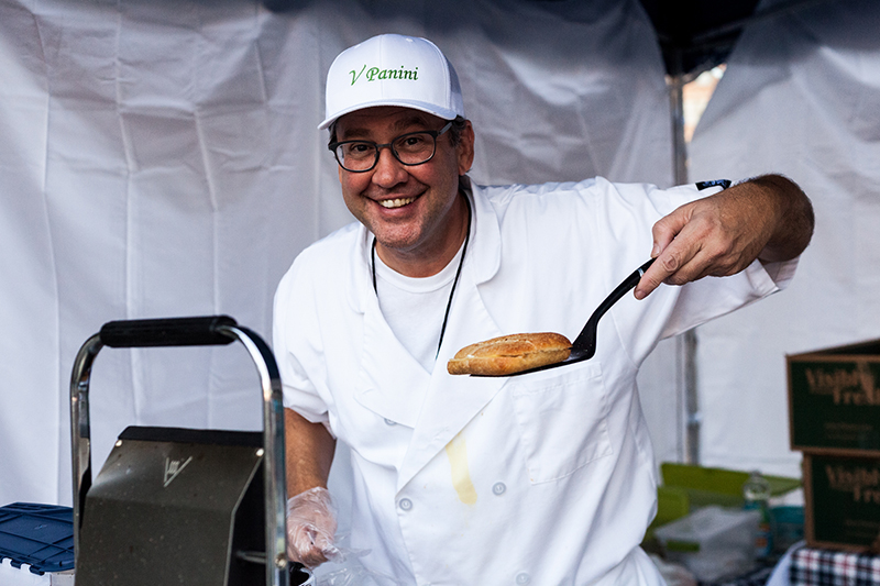 Johnny of V Panini holds up a one of his delectable panini creations. Photo: Chris Gariety