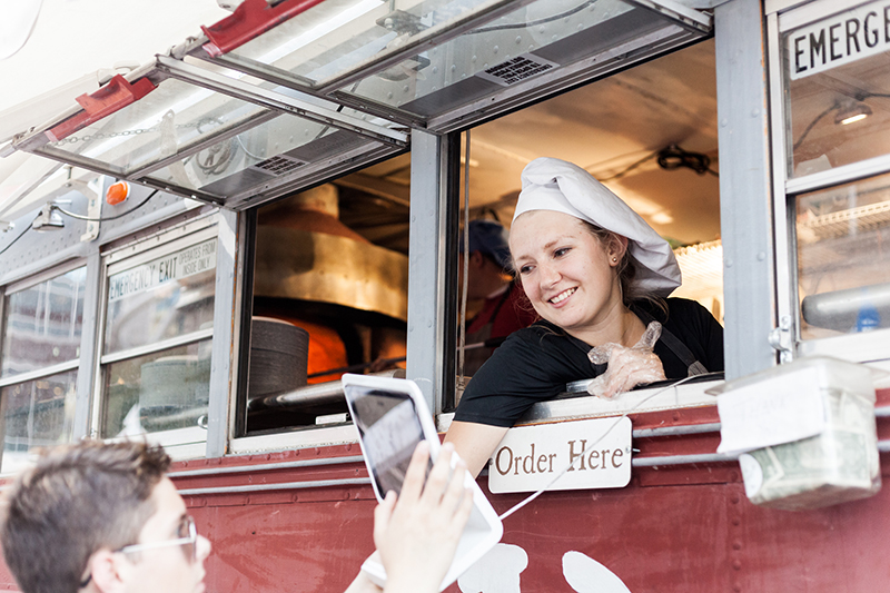 Susie of Pompeii Pizza takes an order with a smile. Photo: Chris Gariety