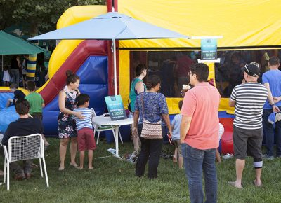Parents watch their children playing in a bounce house. Photo: @jbunds