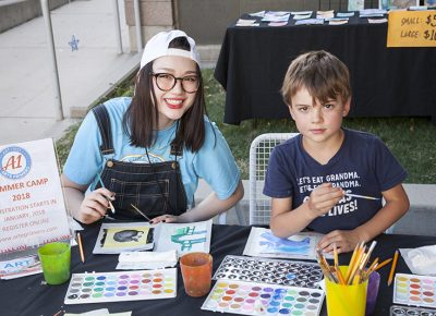 A young girl and a little boy paint side by side. Photo: @jbunds