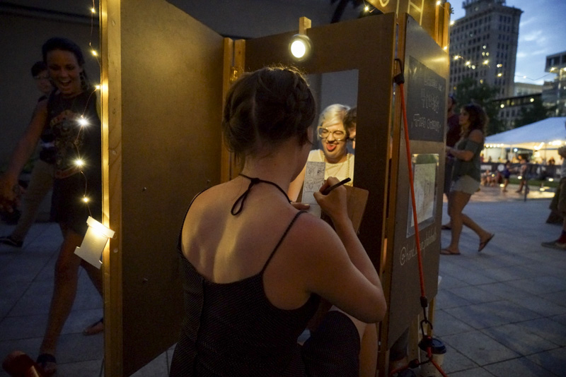 Natalie Allsup-Edwards illustrates at the Hand Drawn Photo Booth. Photo: @jaysonrossphoto