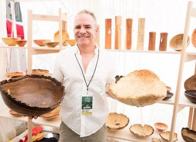 Alan Peck of Peck's Vanilla displays some custom wooden bowls with handmade wooden salt grinders behind. LmSorenson.net