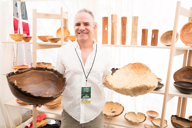 Alan Peck of Peck's Vanilla displays some custom wooden bowls with handmade wooden salt grinders behind. LmSorenson.net