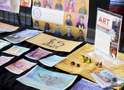 Art made by children at the Arte Primero camp for sale. Photo: @jbunds