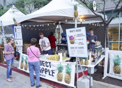 Customers cooling off with a pineapple shaved ice. Photo: @jaysonrossphoto
