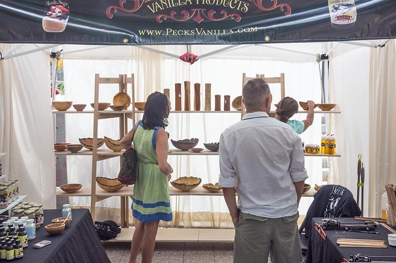 Festival attendees admire Alan Peck's works of art. Photo: @colton_marsala