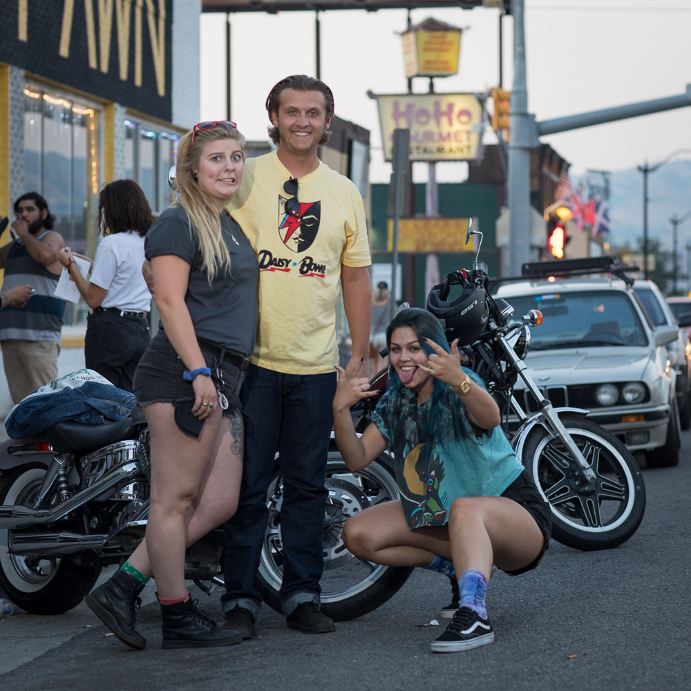 (L–R) Annelise Busch, Jeremy Wilkinson and Rileigh Aleshire pose in front of Busch's and Wilkinson's motorcycles. Busch appreciates the vintage and custom offerings from Gold Blood on 1526 South State. Photo: John Barkiple