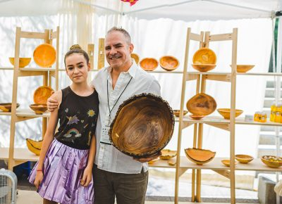 (L–R) Daughter Hadley Peck poses with her father and artist Alan Peck, who founded Peck's Vanilla, HASHI Chopsticks and Beehive Bowls. Photo: @taylnshererphoto