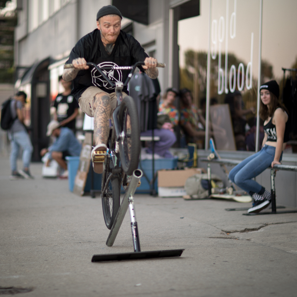 Meth & Macaroni's Byron Sorensen rides an impromptu rail in front of Gold Blood on 1526 South State. He explained M&M's origin story as a low-rent homage to Crooks and Castles' COCAINE & Caviar merchandise. Photo: John Barkiple