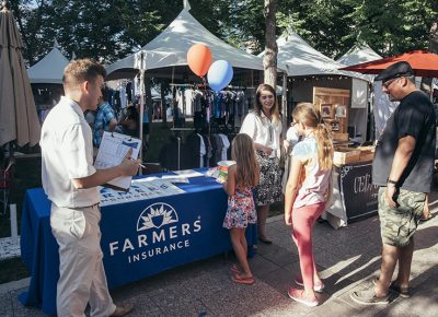 Farmers Insurance greeting visitors with welcoming smiles. Photo: @william.h.cannon