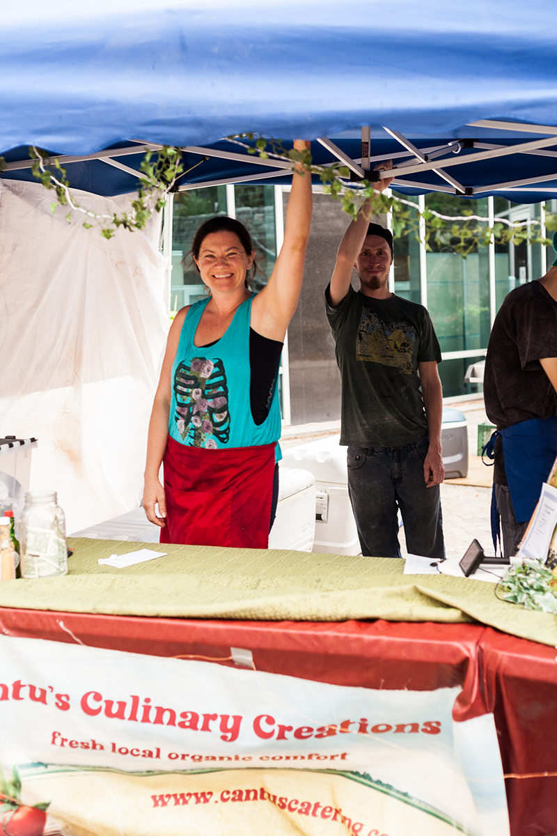 Alyssa of Chef Cantu holds on to her tent during the high winds on Sunday. Photo: Chris Gariety