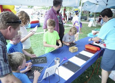 Kids having fun in the crafts portion in the Kids' Area. Photo: @jaysonrossphoto