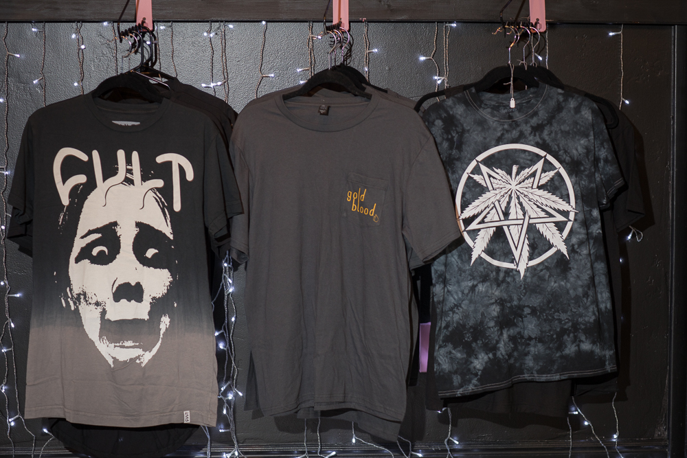 Three T-shirts for sale at Gold Blood. Photo: John Barkiple