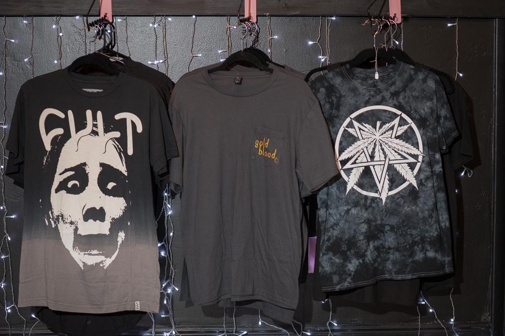 Three T-shirts for sale at Gold Blood. Photo: John Barkiple