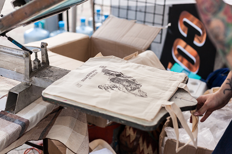 Awesome, live bag screen-printing done by Copper Palate Press. Photo: Chris Gariety