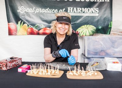 The lovely Leslie prepares some cheese samples at the Harmons tent. Photo: Chris Gariety
