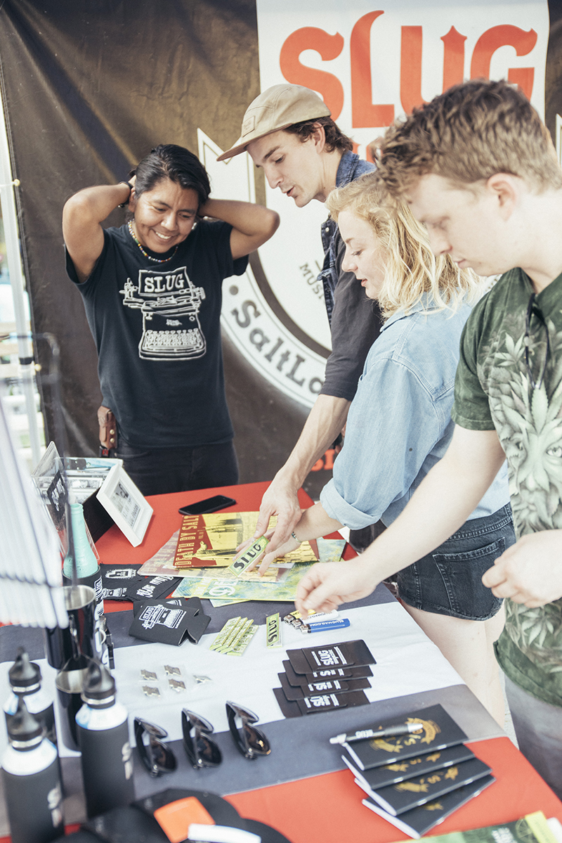 SLUG booth visitors checking out all the sweet new merch. Photo: @william.h.cannon