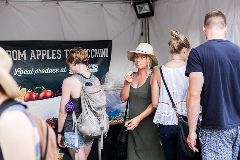 Some satisfied customers trying some free samples from Harmons. Photo: Chris Gariety