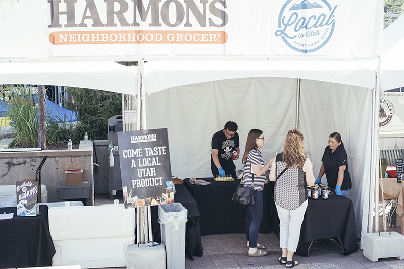 Harmons booth visitors taste-testing local Utah product. Photo: @william.h.cannon
