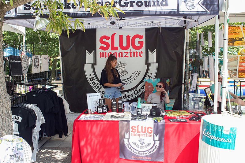 (L–R) Madi Mekkelson and Morgan Valentine volunteering at the SLUG Magazine booth, always smiling amid all their diligent work. @cezaryna
