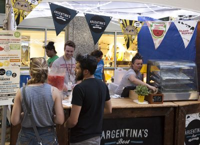 Two patrons look to Argentina's Best Empanadas for the goods featured on their menu. Photo: @jbunds
