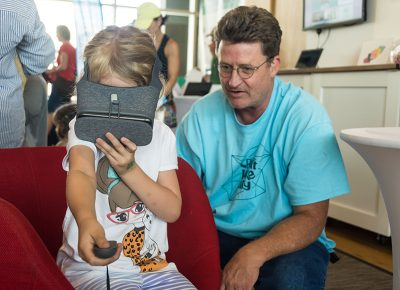 A little girl experiencing virtual reality. Photo: @colton_marsala